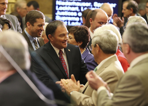 Tom Smart | Pool Governor Gary R. Herbert shakes hands before delivering his 2014 State of the State address Wednesday, Jan. 29, 2014, in Salt Lake City.