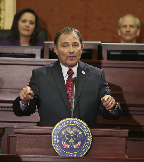 Tom Smart | Pool Governor Gary R. Herbert, with Speaker of the House Becky Lockhart, R-Provo, and Senate President Wayne Neiderhauser, R-Sandy in the back ground, delivers his 2014 State of the State address Wednesday, Jan. 29, 2014, in Salt Lake City.