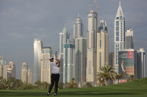 Stephen Gallacher from Scotland follows his ball on the 13th hole during the first round of the Dubai Desert Classic golf tournament in Dubai, United Arab Emirates, Thursday Jan. 30, 2014. (AP Photo/Kamran Jebreili)