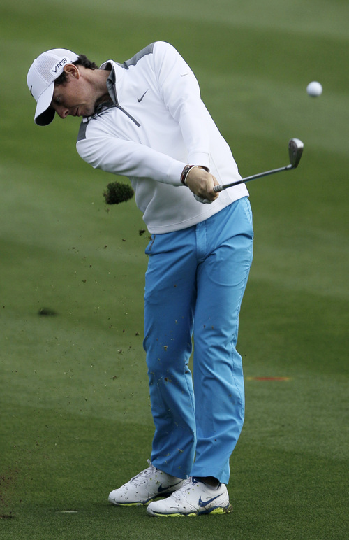Rory McIlroy of Northern Ireland plays a ball on the 14t hole during the first round of the Dubai Desert Classic golf tournament in Dubai, United Arab Emirates, Thursday, Jan. 30, 2014. (AP Photo/Kamran Jebreili)
