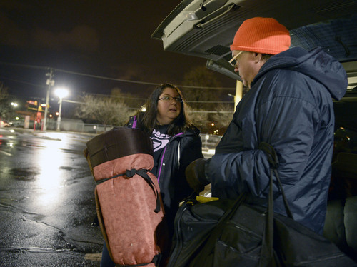 Al Hartmann  |  The Salt Lake Tribune Lilian Browne, case manager with Volunteers of America, gives a sleeping bag to Wiliam McCallmont, a homeless man, Wednesday Jan. 30, 2014, at 5:30 a.m. in downtown Salt Lake City. Each year, Volunteers of America, in conjunction with other agencies, takes a head count of homeless people living on the streets of Salt Lake City.