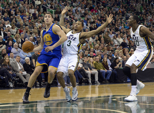 Scott Sommerdorf   |  The Salt Lake Tribune Utah's Trey Burke pulls up as Golden State's Klay Thompson drives to the basket during first period play as the Jazz hosted the Golden State Warriors, Friday, Jan. 31, 2014.