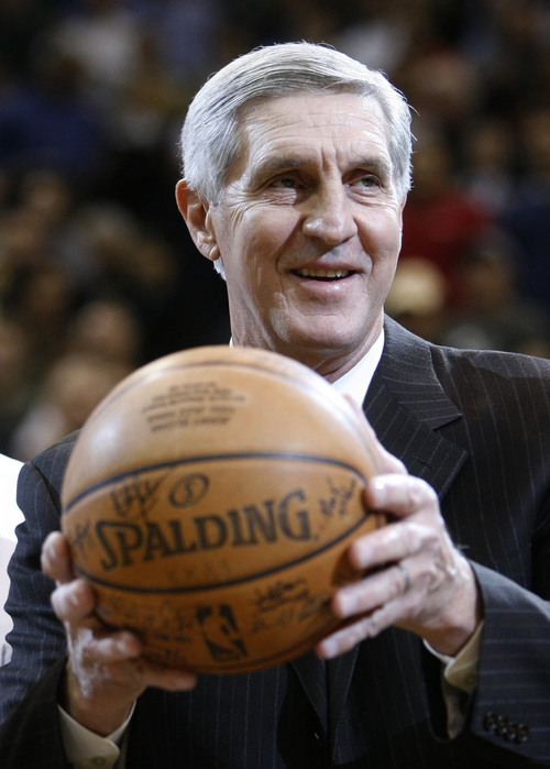 Steve Griffin  |  The Salt Lake Tribune  Utah Jazz head coach Jerry Sloan holds up the game ball from his 1000 victory as he is honored for the achievement prior to the start of the Utah Jazz Milwaukee Bucks game at the EnergySolutions Arena Wednesday  November 19, 2008.