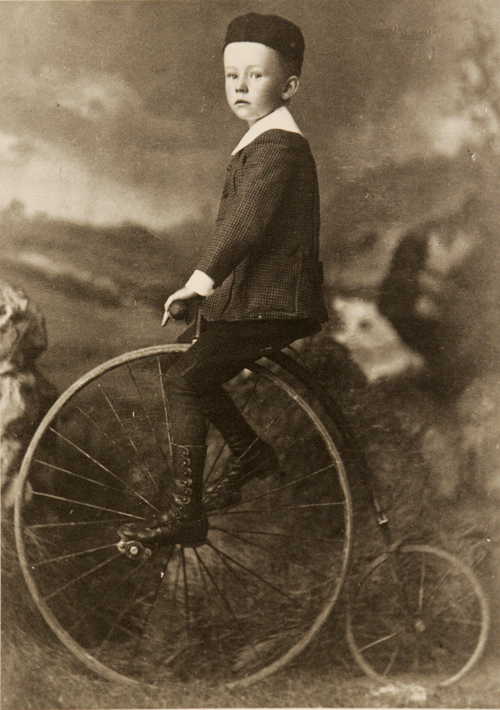 Photos courtesy of Utah Historical Society  Little boy on an old-fashioned bicycle.
