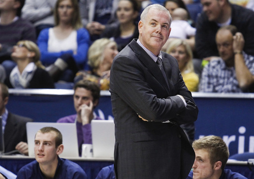 BYU head coach Dave Rose smiles as he walks the sideline in the final minutes of the NCAA men's basketball game between BYU and University of North Texas at the Marriott Center in Provo on Tuesday, Dec. 3, 2013. BYU won the game 97-67. SPENSER HEAPS   Daily Herald