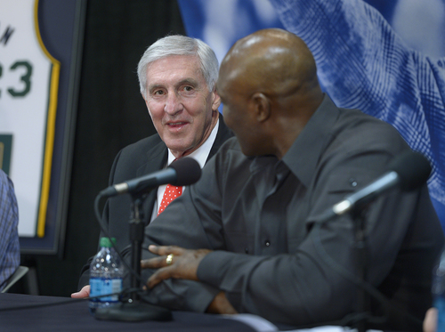 Scott Sommerdorf      The Salt Lake Tribune Former Jazz coach Jerry Sloan listens as Karl Malone tells a story about their time together with the Jazz at a press conference to honor Sloan. Former Jazz greats Karl Malone and John Stockton as well as Jazz owner / CEO Greg Miller spoke, Friday, Jan. 31, 2014.