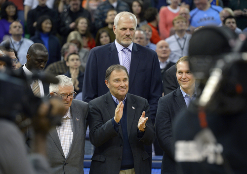 Scott Sommerdorf   |  The Salt Lake Tribune Utah Governor Gary Herbert applauds as he is towered over by former Jazz player Mark Eaton as former Jazz coach Jerry Sloan is honored at halftime of the Utah Jazz vs Golden State Warriors game, Friday, Jan. 31, 2014.