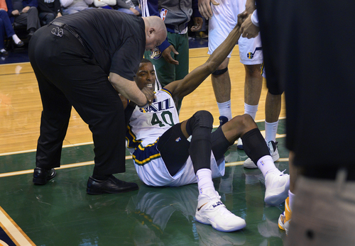 Scott Sommerdorf   |  The Salt Lake Tribune Utah's Jeremy Evans fell hard toward the end of the first half, and had to be helped up. The Golden State Warriors beat the Utah Jazz 95-90, Friday, Jan. 31, 2014.