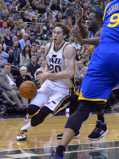 Scott Sommerdorf   |  The Salt Lake Tribune Utah's Gordan Hayward loses control of the ball as he drives during an critical point late in the game. The Golden State Warriors beat the Utah Jazz 95-90, Friday, Jan. 31, 2014.