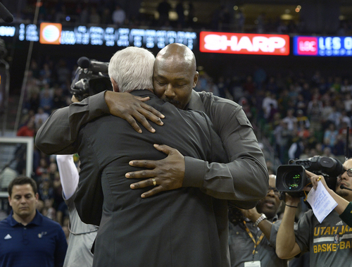 Scott Sommerdorf   |  The Salt Lake Tribune Jazz great Karl Malone hugs his former coach Jerry Sloan after he spoke to the crowd and told Sloan how much he loved him, during halftime as the Jazz hosted the Golden State Warriors, Friday, Jan. 31, 2014.