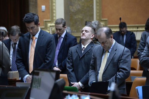 Francisco Kjolseth  |  The Salt Lake Tribune House representatives at the state Capitol hold a moment of silence in honor and support of Sgt. Cory Wride who was killed Thursday and Utah County Deputy Greg Sherwood who was injured in the incident involving a convicted felon who led officers on a high speed chase.