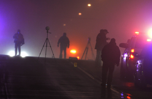 Keith Johnson | The Salt Lake Tribune  Law enforcement agents investigate a crime scene in Santaquin, Utah related to an officer-involved shooting, January 31, 2014.