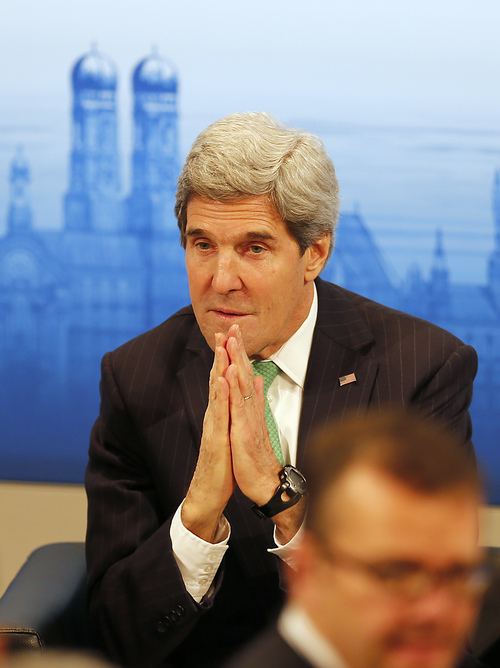 US Secretary of State,  John Kerry, listens during the 50th Security Conference in Munich, Germany, Saturday, Feb. 1, 2014. The conference on security policy takes place from Jan.31,2014 until Feb. 2,2014.  ( AP Photo/Frank Augstein)