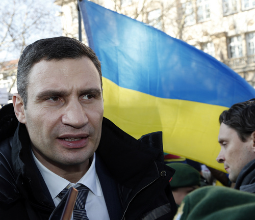 Ukraine's opposition leader Vitali Klitschko joins a demonstration  to support the opposition during  the 50th Security Conference in Munich, Germany, Saturday, Feb. 1, 2014. The conference on security policy takes place from Jan. 31, 2014 to Feb 2, 2014. (AP Photo/Frank Augstein)
