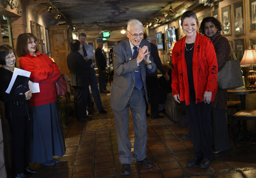 Scott Sommerdorf   |  The Salt Lake Tribune Lennox Tierney bows as he greets koto musicians Hatsumi Bryant and Kimiko Osterloh as he enters his 100th birthday party. Cathy Edens, right, a former student of his, organized the party. Tierney perserved Japanese art as Arts and Monuments Commissioner under Gen. Douglas MacArthur after WWII. The party was held at La Caille, Sunday, Jan. 26, 2014.