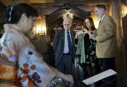 Scott Sommerdorf   |  The Salt Lake Tribune Lennox Tierney, center, listens to the koto group of Kimiko Osterloh, foreground, and Hatsumi Bryant, off camera. Tierney perserved Japanese art as Arts and Monuments Commissioner under Gen. Douglas MacArthur after WWII. The party was held at La Caille, Sunday, Jan. 26, 2014.