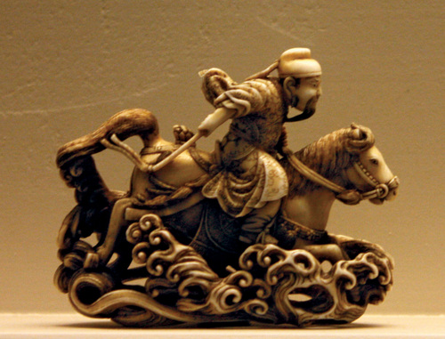 | Courtesy Encyclopedia Britannica Creative Commons An example of netsuke, a type of miniature Japanese sculpture. This 19th century ivory example in London's Victoria and Albert Museum shows the Chinese general Gentokuyo (Quan Deyu) riding a horse through water. Photo by Valerie McGlinchey, Victoria and Albert Museum, London.