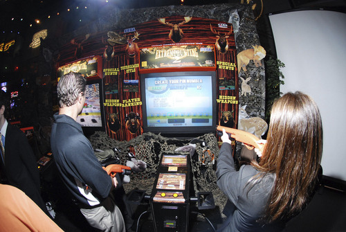 PRNewsFoto/GameWorks Game players at GameWorks in Schaumburg fight to win in Extreme Hunting 2 - Tournament Edition, using SEGA's new online platform, ALL.Net, coming soon to the United States.