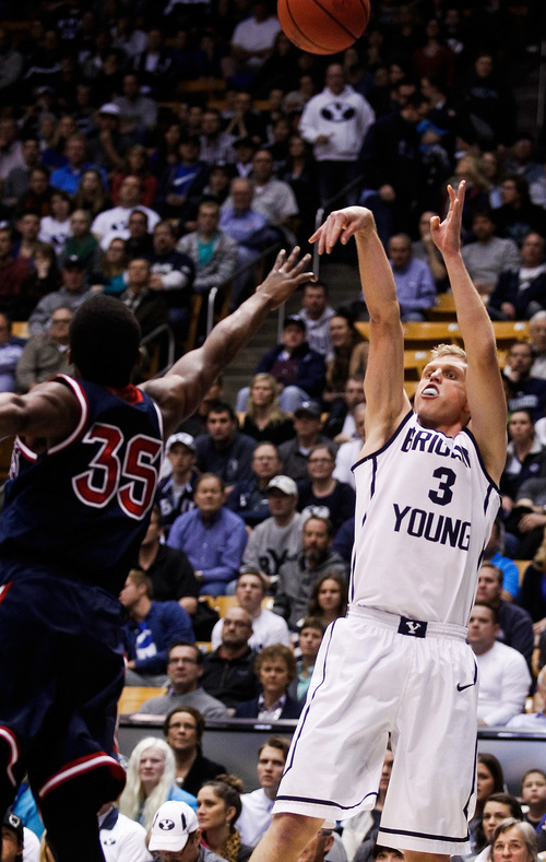 BYU's Tyler Haws shoots past Saint Mary's James Walker III, left, during the NCAA basketball game between Brigham Young University and Saint Mary's at the Marriott Center in Provo on Saturday, Feb. 1, 2014. (AP Photo/The Daily Herald, Spenser Heaps)