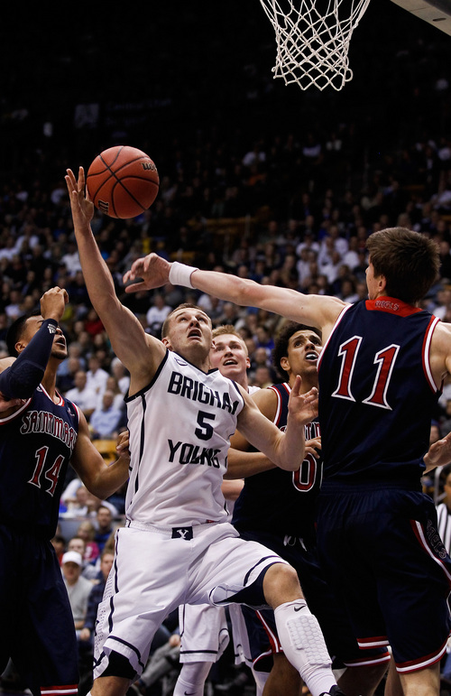 BYU's Kyle Collinsworth lays it up during the NCAA basketball game between Brigham Young University and Saint Mary's at the Marriott Center in Provo on Saturday, Feb. 1, 2014. (AP Photo/The Daily Herald, Spenser Heaps)