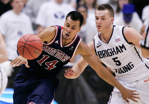 Saint Mary's Stephen Holt, left, and BYU's Kyle Collinsworth, right, race for a loose ball during the NCAA basketball game between Brigham Young University and Saint Mary's at the Marriott Center in Provo on Saturday, Feb. 1, 2014. BYU won the game 84-71. (AP Photo/The Daily Herald, Spenser Heaps)