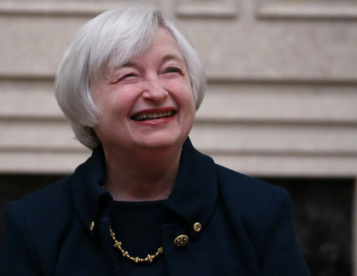 Janet Yellen smiles after being sworn in as Federal Reserve Board Chair, Monday, Feb. 3, 2014, in Washington, Yellen is the first woman to lead the Federal Reserve. (AP Photo/Charles Dharapak)