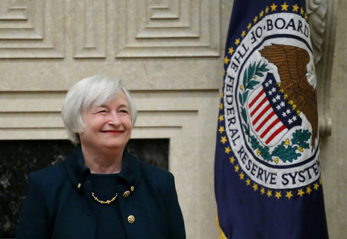 Janet Yellen smiles before being sworn in as Federal Reserve Board chair, Monday, Feb. 3, 2014, at the Federal Reserve, in Washington. Yellen is the first woman to lead the Federal Reserve.  (AP Photo/Charles Dharapak)