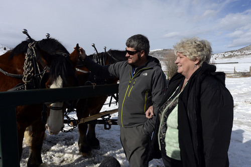 Francisco Kjolseth  |  The Salt Lake Tribune Salt Lake Tribune Outdoors writer Brett Prettyman pets the Clydesdales Little Foot and Beauty alongside his mother Pam McLeese after taking a ride on a wagon near elk at Hardware Ranch Wildlife Management Area in Blacksmith Fork Canyon.