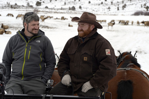 Francisco Kjolseth  |  The Salt Lake Tribune Tribune Outdoors writer Brett Prettyman leans about the Hardware Ranch Wildlife Management Area from Ranch manager Brad Hunt during a recent winter weekend.