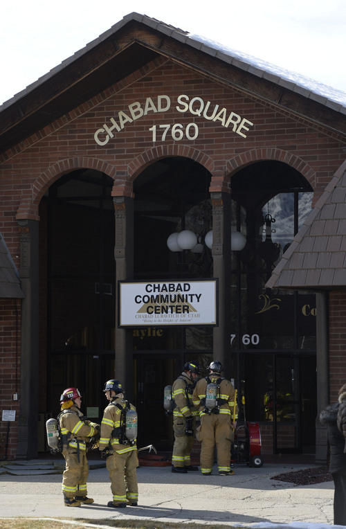 Francisco Kjolseth  |  The Salt Lake Tribune Firefighters try to determine the source of the smell of smoke reported at the Chabad Community Center at 1760 South 1100 East in Salt Lake City on Monday, Feb. 3, 2014. Several children from the day care were safely removed as while the investigation continues.