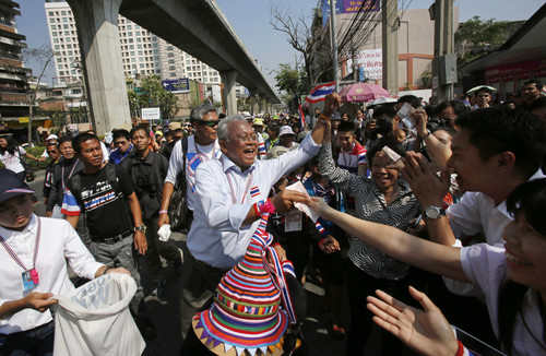 Anti-government protest leader Suthep Thaugsuban collects donation from supporters during a march through Bangkok, Thailand, Monday, Feb. 3, 2014. Thai protesters vowed Monday to stage larger rallies in central Bangkok and push ahead their efforts to nullify the results of elections that were expected to prolong a national political crisis. (AP Photo/Wally Santana)