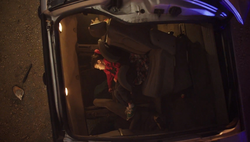 In this screen shot of a Utah Department of Transportation Super Bowl advertisement, a young boy is dead at a staged accident scene because of his parent's failure to buckle up.