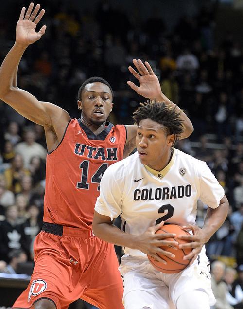 Colorado's Xavier Johnson drives past Utah's Dakarai Tucker during the first half of an NCAA college basketball game Saturday, Feb. 1, 2014, in Boulder, Colo. (AP Photo/The Daily Camera, Cliff Grassmick) NO SALES