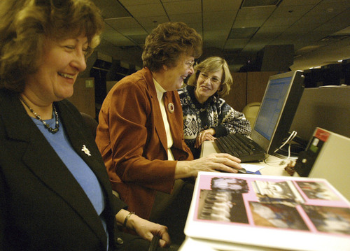 | Tribune file photo  Shirlene Jolley, left, Janet Enke, center and Carolyn Hughes, right, laugh at a story from Janet Enke's family history at the Family History Library in Salt Lake City.
