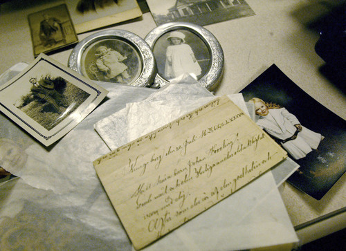 | Tribune file photo  Janet Enke has collected many of her family's pictures and letters from the past century. The letter written in Swedish from a town named Kungsburg gave Enke her first clue of where to start looking in her family's history.