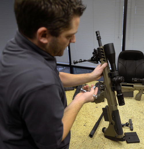 Steve Griffin  |  The Salt Lake Tribune  Seth Ercanbrack, marketing manager for Desert Tech in West Valley City, Utah, changes out the barrel of a SRS Covert sniper rifle at the company's offices Friday, January 31, 2014. Desert Tech is a Utah gun manufacturer developing one of the more accurate military rifles on the market.