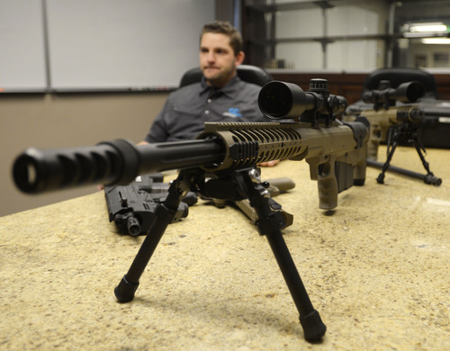 Steve Griffin  |  The Salt Lake Tribune  Seth Ercanbrack, marketing manager for Desert Tech in West Valley City, Utah, with a Hard Target Interdiction (HTI) sniper rifle at the company's offices Friday, January 31, 2014. Desert Tech is a Utah gun manufacturer developing one of the more accurate military rifles on the market.