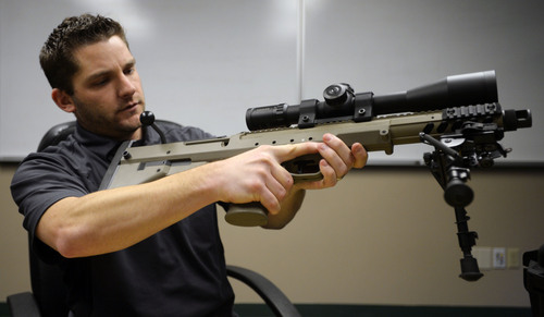 Steve Griffin  |  The Salt Lake Tribune  Seth Ercanbrack, marketing manager for Desert Tech in West Valley City, Utah, with a SRS Covert sniper rifle at the company's offices Friday, January 31, 2014. Desert Tech is a Utah gun manufacturer developing one of the more accurate military rifles on the market.