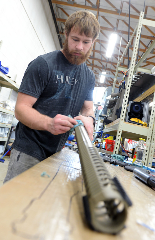 Steve Griffin  |  The Salt Lake Tribune  Rocky Fonnesbeck of Desert Tech in West Valley City, Utah, puts the finishing touches on a receiver at the company's offices Friday, January 31, 2014. Desert Tech is a Utah gun manufacturer developing one of the more accurate military rifles on the market.