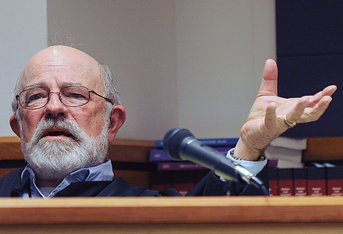 """FILE - In this undated file photo, Montana District Judge G. Todd Baugh presides at a hearing in Great Falls, Mont. A judicial oversight board says  Baugh should be disciplined for saying a 14-year-old rape victim was """"older than her chronological age"""" when he sentenced her rapist to just one month in prison. (AP Photo/Billings Gazette, Larry Mayer, File)"""