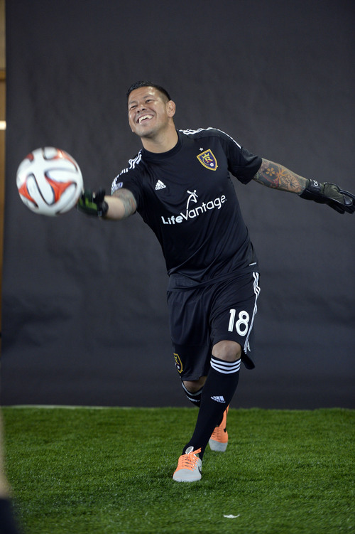 Francisco Kjolseth  |  The Salt Lake Tribune Nick Rimando lobs a gentle pass as he teases the photographer getting action portraits as Real Salt Lake convenes for its 2014 Media Day four weeks ahead of the season opener on March 8, at the Ardell Brown Recreational building in Sandy on Tuesday, Feb. 4, 2014.