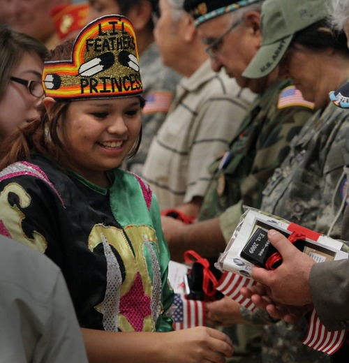 Rick Egan   |  The Salt Lake Tribune  Deo Tso, a Navajo youth princess, presents American Indian veterans with gifts on Nove. 11, 2010, at Copperview Recreation Center in Midvale. In honor of Native American Heritage Month and Veterans Day, Canyons School District invited American Indian students and their family members to a special ceremony and a workshop on preparing for college and careers.