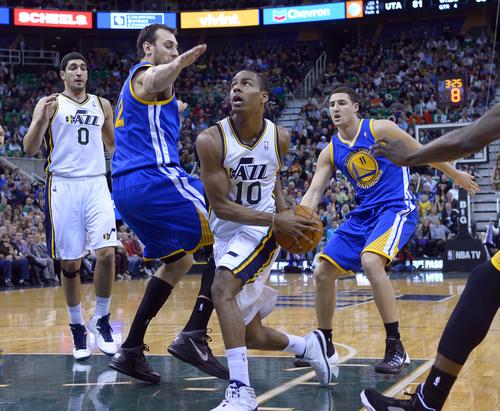 Scott Sommerdorf   |  The Salt Lake Tribune Utah's Alec Burks tries to dribble around the defense of Andrew Bogut during second half play. The Golden State Warriors beat the Utah Jazz 95-90, Friday, Jan. 31, 2014.