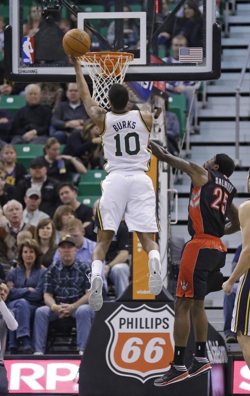 Utah Jazz's Alec Burks (10) goes to the basket as Toronto Raptors' John Salmons (25) defends in the second quarter of an NBA basketball game Monday, Feb. 3, 2014, in Salt Lake City. (AP Photo/Rick Bowmer)