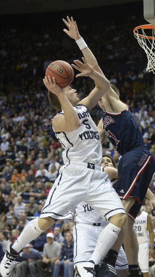 Rick Egan  | The Salt Lake Tribune   Brigham Young Cougars guard Kyle Collinsworth (5) shoots as St. Mary's Gaels forward Dane Pineau (11) in basketball action, BYU vs. St Mary's, at the Marriott Center, Saturday, February 1, 2014.