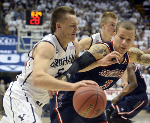 Rick Egan  | The Salt Lake Tribune   Brigham Young Cougars guard Kyle Collinsworth (5) drives to the basket, as St. Mary's Gaels guard Kerry Carter (3) defends, in basketball action, BYU vs. St Mary's, at the Marriott Center, Saturday, February 1, 2014.