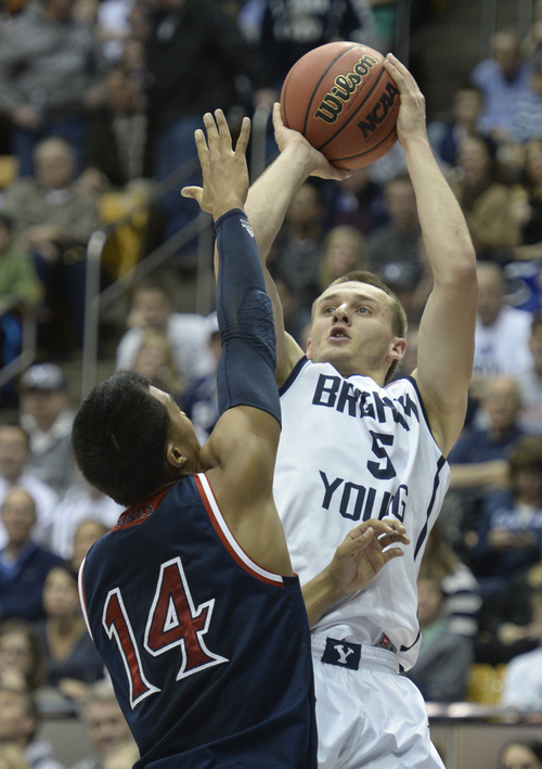 Rick Egan  | The Salt Lake Tribune   Brigham Young Cougars guard Kyle Collinsworth (5) shoots over St. Mary's Gaels guard Stephen Holt (14) in basketball action, BYU vs. St Mary's, at the Marriott Center, Saturday, February 1, 2014.