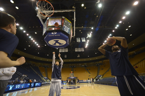 Rick Egan  | The Salt Lake Tribune   Brigham Young Cougars guard Kyle Collinsworth (5) and guard Anson Winder (20) warm up before the BYU  vs. St Mary's game at the Marriott Center, Saturday, February 1, 2014.