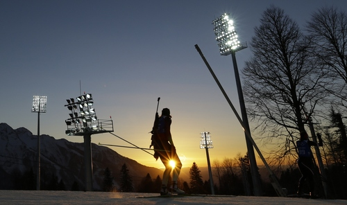 An athlete is silhouetted during a biathlon training session ahead of the 2014 Winter Olympics, Thursday, Feb. 6, 2014, in Krasnaya Polyana, Russia. (AP Photo/Kirsty Wigglesworth)
