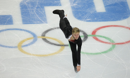 Evgeny Plyushchenko of Russia competes in the men's team short program figure skating competition at the Iceberg Skating Palace during the 2014 Winter Olympics, Thursday, Feb. 6, 2014, in Sochi, Russia. (AP Photo/Vadim Ghirda)